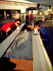 Doing the boat races at the Boy Scout booth.