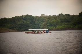 kids on their way to school in the mornings on the Amazon river.